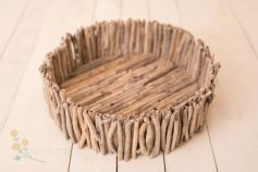 Driftwood bowl made of thin vertical sticks